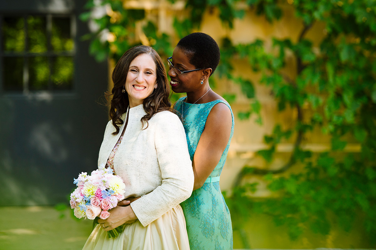 Portrait of two Brides on their wedding day.