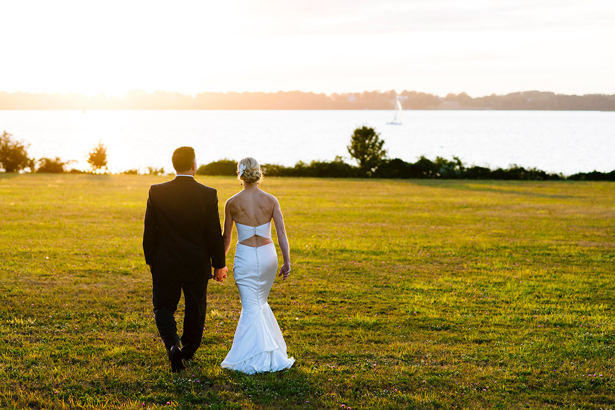 Bride and Groom walk to the waterfront at Blithewold Mansion