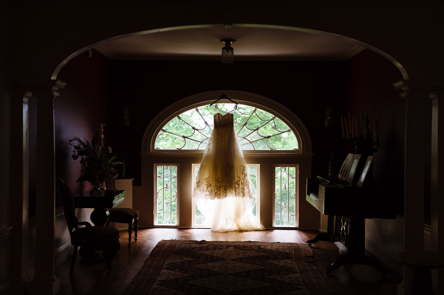 Bridal gown hanging in Linden Place