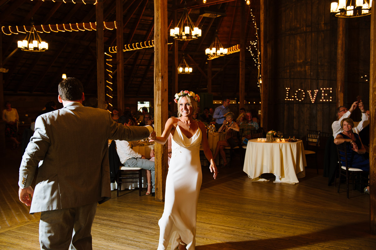 Couples first dance inside the barn at The Inn at Round Barn Farm
