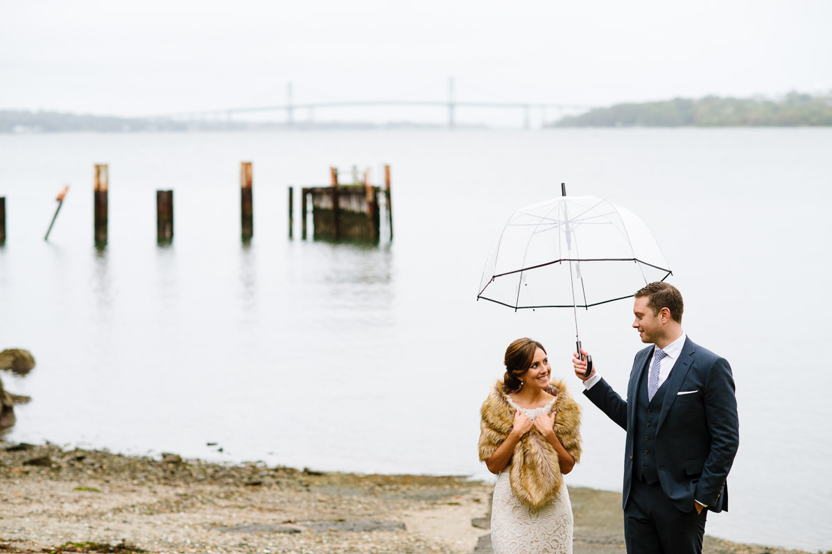 Portrait of a bride and groom on their rainy wedding day