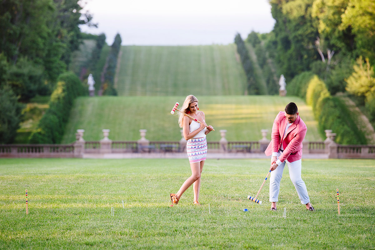 Engaged couple playing croquet during their engagement session