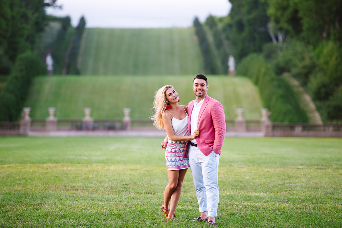 Engaged couple with Crane Estate rolling hills