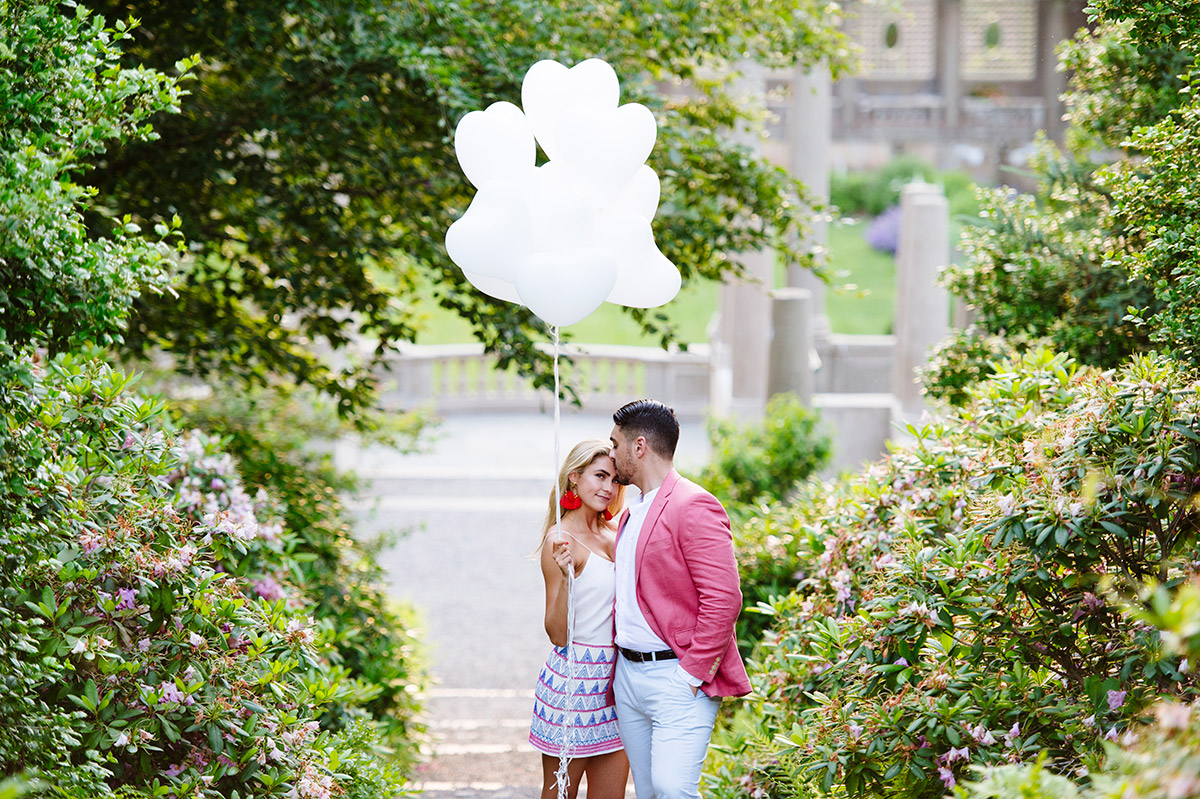 Engaged couple in the Italian Garden with heart shaped balloons