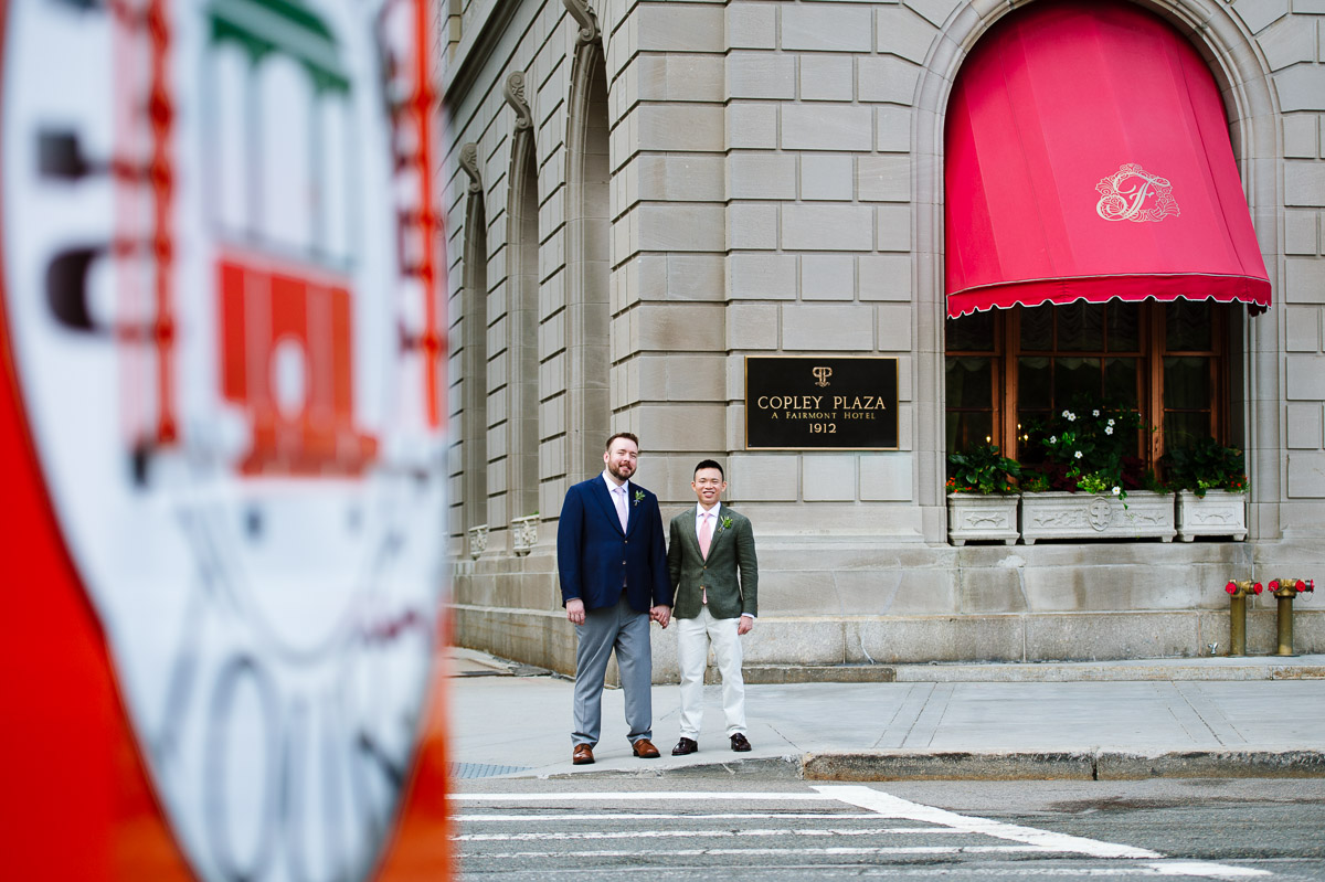 Boston wedding portrait with two Grooms, a trolley, and the Fairmont Copley Plaza