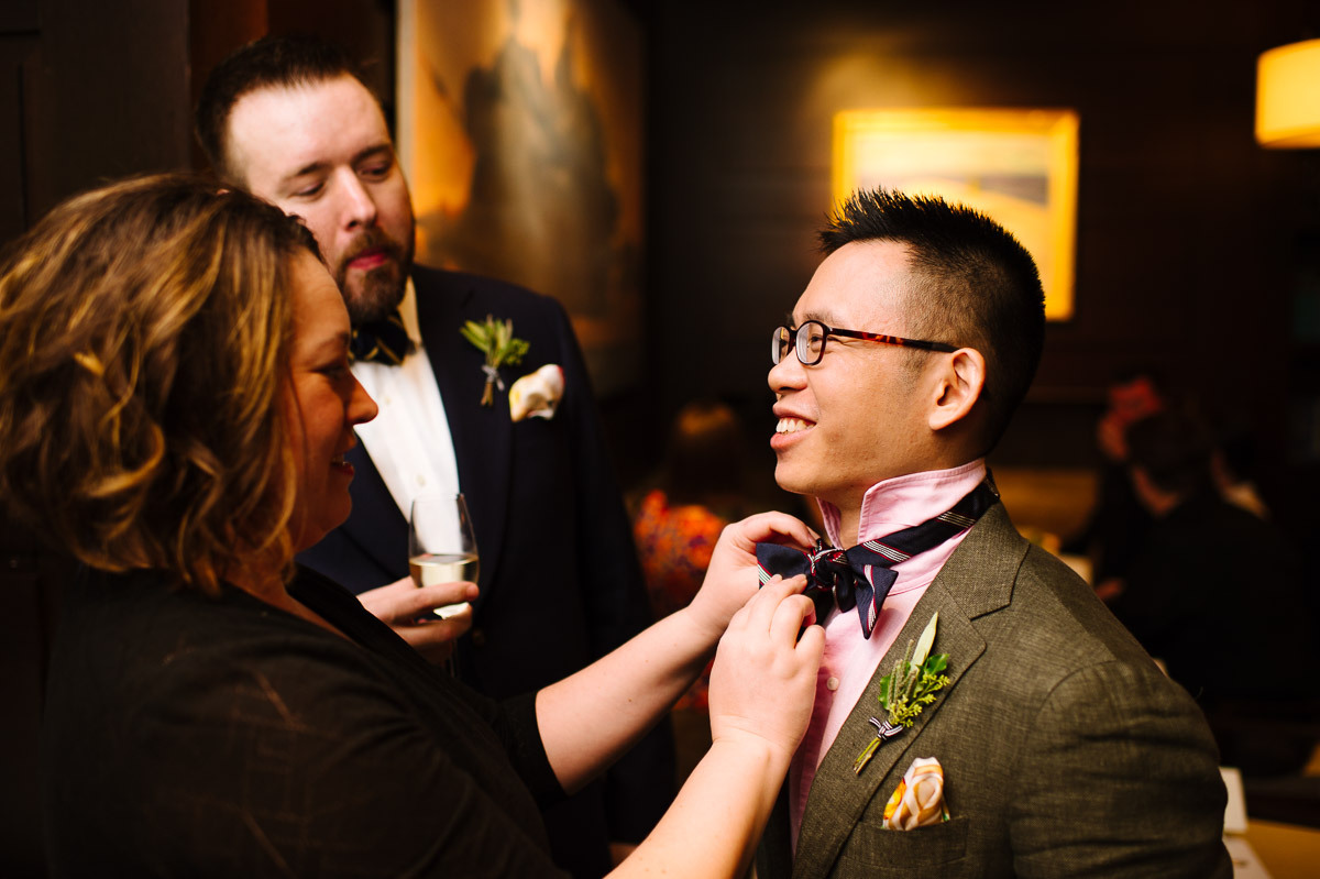 Grooms get ready for their dinner reception at L'Espalier