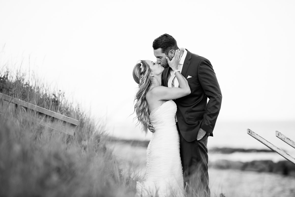 Wedding day portrait in the tall grasses of Pelham House Resort
