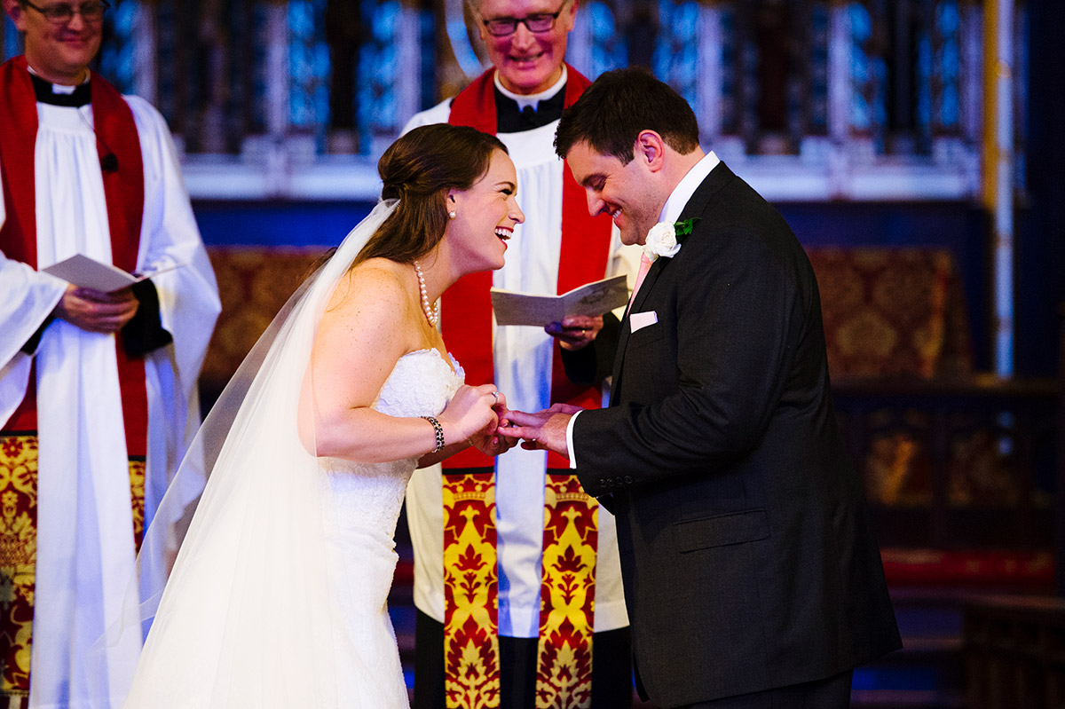 Couple exchanges wedding rings at All Saints Parish in Brookline