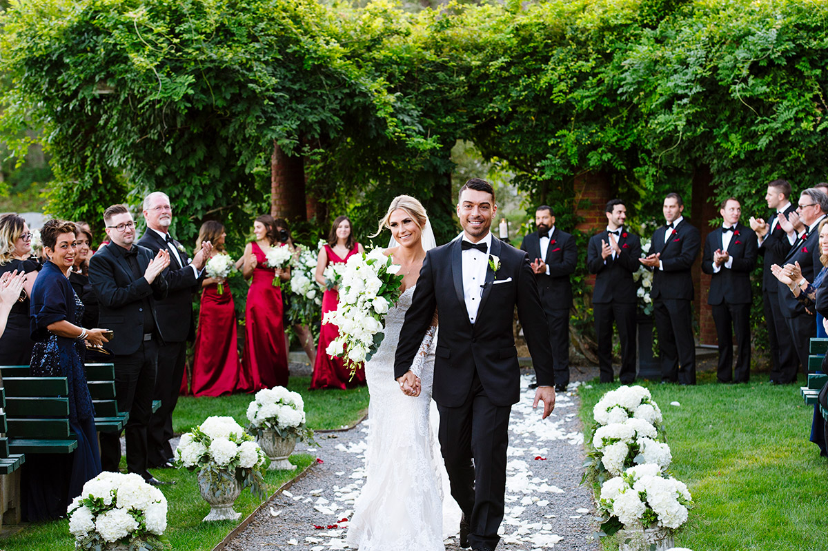 Bride and Groom recess up the aisle after their ceremony at Turner Hill Mansion