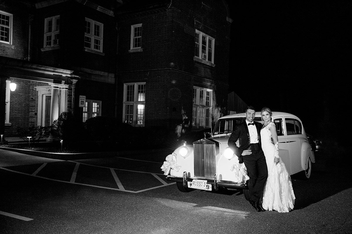 Bride and Groom leave in a Rolls Royce