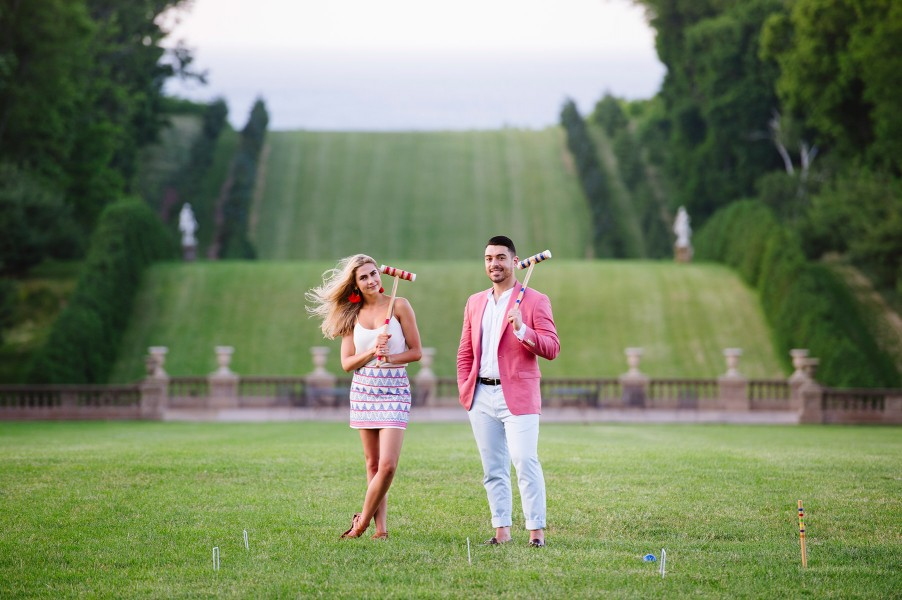 Engaged couple plays croquet at Crane Estate