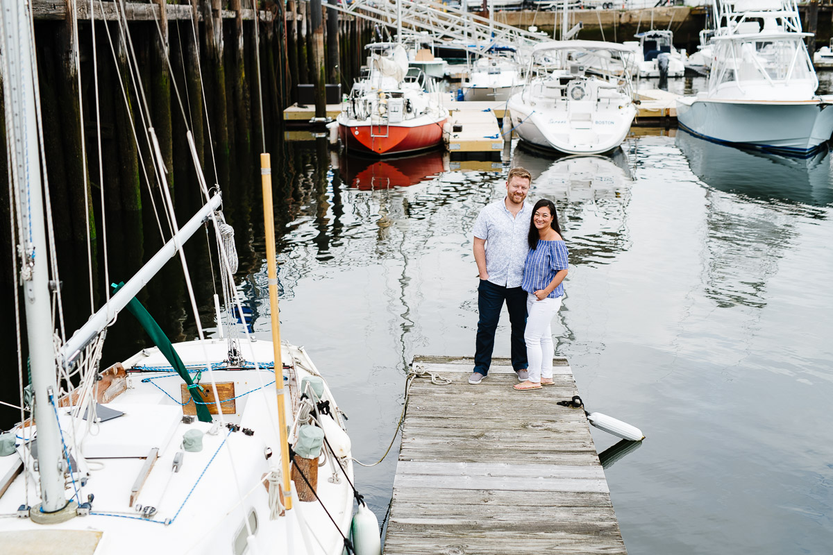 Couple on a dock in Boston Harbor Shipyard & Marina
