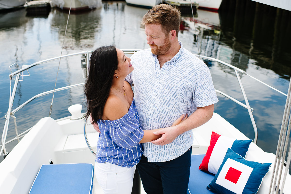 Engagement session on a couple's sailboat