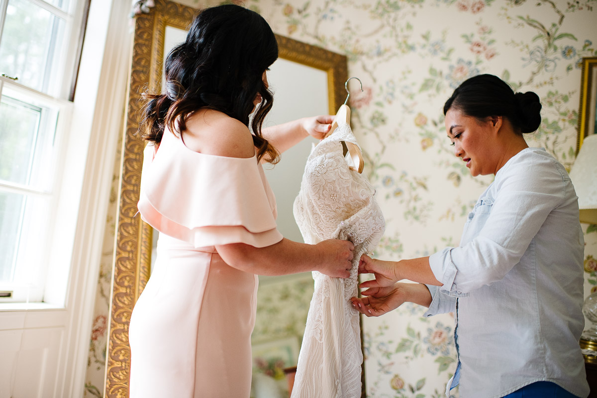 Bride and Maid of Honor get ready at the Bradley Estate